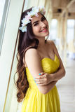 Beautiful young woman with long hair in a summer day. bridesmaid in yellow dress in a sea restaurant. Fashion beauty portrait Stock Images