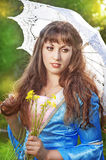 Beautiful young woman with long hair and umbrella Stock Images