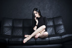 Beautiful young woman with long legs in bodysuit Royalty Free Stock Photo