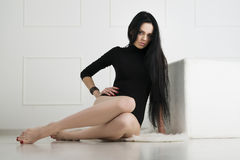 Beautiful young woman with long legs in bodysuit Stock Photography