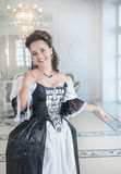 Beautiful young woman in long medieval dress Stock Photography