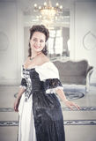 Beautiful young woman in long medieval dress Royalty Free Stock Photo