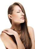 Beautiful young woman with long shiny hair Stock Image