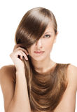 Beautiful young woman with long shiny hair Royalty Free Stock Images