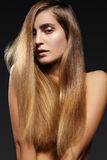 Beautiful young woman with long shiny hair. Healthy long straight hairstyle. Sexy model woman Stock Image