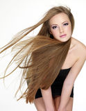 Beautiful young woman with  long straight hair. Portrait on white background Stock Photo
