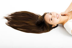 Beautiful young woman with long straight hair Stock Photography