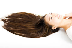 Beautiful young woman with long straight hair Royalty Free Stock Photography