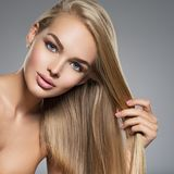 Beautiful young woman with long  straight  hairs. Portrait of  a beautiful young woman with long light straight  hairs and brown make-up.  Face of a fashion Royalty Free Stock Photo
