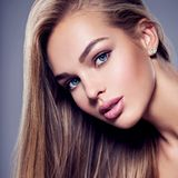 Beautiful young woman with long  straight  hairs. Portrait of  a beautiful young woman with long light straight  hairs and brown make-up.  Face of a fashion Stock Photo