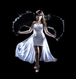 Beautiful young woman in a long white dress and with black wings Stock Photos