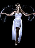 Beautiful young woman in a long white dress and with black wings Stock Photography