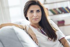 Beautiful young woman look at camera stock photos