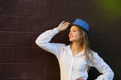 Beautiful young woman looking away with hat Royalty Free Stock Images