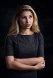 Beautiful young woman looking away. Studio portrait of beautiful young woman looking away Stock Photos