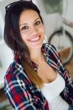 Beautiful young woman looking at camera at home. Stock Photography