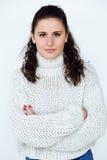 Beautiful young woman looking at camera at home. Royalty Free Stock Image
