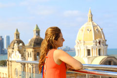 Beautiful young woman looking at Cartagena, Colombia. With the Caribbean Sea visible on two sides Stock Photos