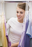 Beautiful Young Woman Looking Through Closet Stock Images