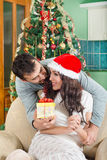 Beautiful Young Woman Looking Gift Box and Smiling While Her Boy stock photography