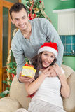 Beautiful Young Woman Looking Gift Box and Smiling While Her Boy royalty free stock photo