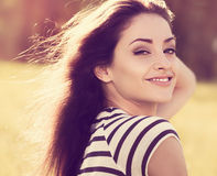 Beautiful young woman looking happy with long hair on nature sum Royalty Free Stock Photography