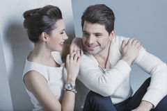 Beautiful young woman looking at her man royalty free stock images