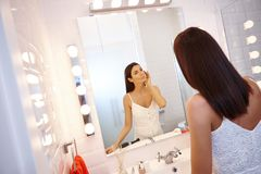 Beautiful woman in bathroom stock photography