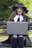 Beautiful young woman looking at laptop Royalty Free Stock Photo