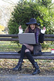 Beautiful young woman looking at laptop Royalty Free Stock Photography