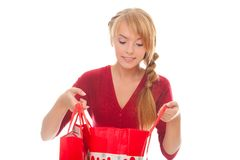 Beautiful young woman looking in shopping bag Stock Image