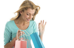 Beautiful Young Woman Looking Into Shopping Bags Royalty Free Stock Images