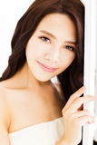 Beautiful young woman looking and smiling Royalty Free Stock Photography