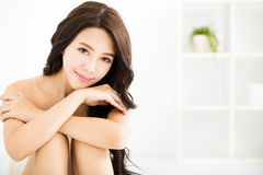 Beautiful young woman looking and smiling Stock Photo