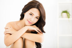 Beautiful young woman looking and smiling Royalty Free Stock Photos