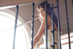 Beautiful Young Woman Looking Through Stairwell Royalty Free Stock Photo