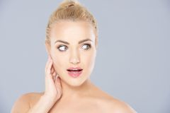Beautiful young woman looking surprised Stock Photo