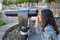 Beautiful young woman looking through touristic telescope Royalty Free Stock Photos