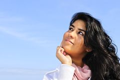 Beautiful young woman looking up Stock Image