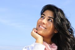 Beautiful young woman looking up Stock Photo