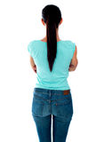 Beautiful young woman looking at wall. Rear view Royalty Free Stock Photos