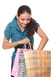 Beautiful young woman looks bag shopping Stock Image