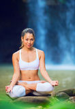 Beautiful Young Woman in Lotus Position Stock Photography