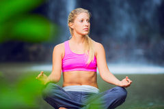Beautiful Young Woman in Lotus Position Royalty Free Stock Photo