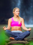 Beautiful Young Woman in Lotus Position Royalty Free Stock Photos
