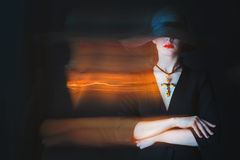 Beautiful young woman with luminous twinkle trail. Portrait of beautiful young woman in black hat with luminous twinkle trail by light painting stock photos