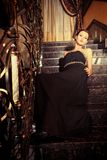 Lady on stairs Royalty Free Stock Photography