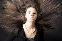 Beautiful young woman with luxurious hair Royalty Free Stock Image