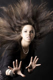Beautiful young woman with luxurious hair stock photo