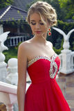 Beautiful young woman in luxurious red dress Royalty Free Stock Image
